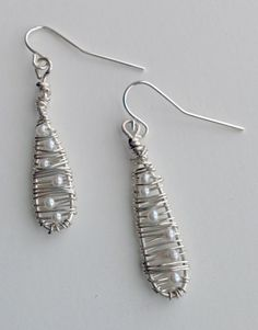 silver wire wrapped earrings with freshwater pearls  http://www.etsy.com/shop/ScissorsAndPearls