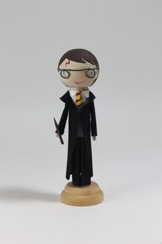 The chosen one himself! Complete with his rounded glasses, red scar, and wand.      This is an Etsy original found exclusively at Left on Lynna