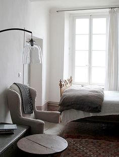 Cool lamp! i bet the head board is amazingly beautiful on this bed. Supply Paper Co. | Marston House: Bonnieux, Provence