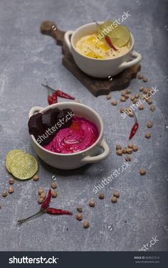 Two varieties of hummus red and natural additives cumin