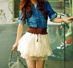 A denim shirt is perfectly paired with a feminine white skirt. Add a cute belt and some cowgirl boots and you've got a great outfit for any occasion!
