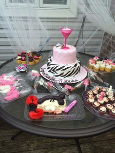 Bridal/Bachelorette party set up outside chocolate lollipops, chocolate covered pretzels cupcakes with themed chocolate toppings