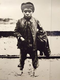 Italian immigrant boy arriving on Ellis Island. Picture was taken in 1918 and is displayed on Ellis Island.