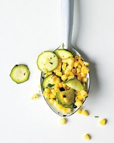 Raw Corn & Zucchini Salad  3 ears corn, husks and silks removed   2 medium zucchini, thinly sliced   2 tablespoons fresh lime juice   2 tablespoons extra-virgin olive oil   2 tablespoons coarsely chopped fresh cilantro   Coarse salt and ground
