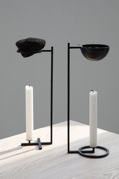 'NOSTALGIA' by Sanna Völker. Two geometric candle sticks become scent diffusers. One that uses a volcanic rock combined with essential heat oil. The other with water and dried herbs or leaves.  With Nostalgia fond memories will be awaken or new ones created.