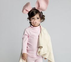 Girl in homemade pig costume. Instructions on how to make pig ears and snout.