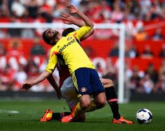 Fabio Borini of Sunderland is brought down by Michael Carrick of Manchester United during the Barclays Premier League match between Manchest...