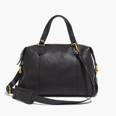 The Kensington Satchel, $198 at Madewell. Black leather satchel with equestrian-inspired hardware. The duffel strap makes this a super-comfortable bag to carry, even with a heavy load.