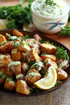 Spicy, crispy roasted Creamer potatoes drizzled with the most luxurious and addictive Lemon Garlic Avocado Aioli. Mmm!