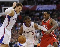 Clippers' point guard Chris Paul drives past Atlanta Hawks point guard Jeff Teague as power forward Blake Griffin, gets out of the way. The Clippers won 96-82. #NBA #basketball #CP3