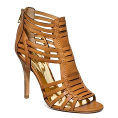 Coach Lucy Heel ($169) ❤ liked on Polyvore featuring shoes, sandals, heels, sapatos, ginger, strappy heeled sandals, strappy sandals, metallic heeled sandals, leather sole sandals and woven leather sandals