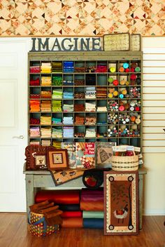 love this old antique for storing fabrics...it's probably an old postal sorting station.