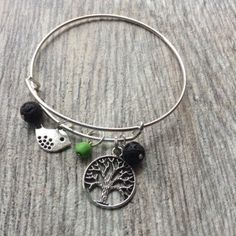 A personal favorite from my Etsy shop https://www.etsy.com/listing/253769257/tree-of-life-bird-charm-lava-rock