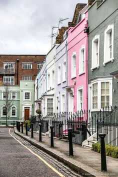A row of colorful houses on a side street off King's Road in Chelsea, London. #houses #london #chelsea