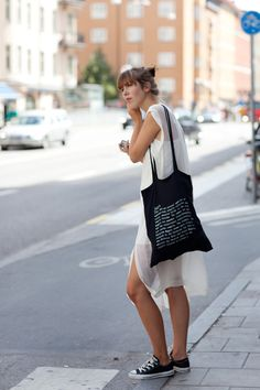 I've been rocking the dress+converse look all summer long. Now, seeing several examples on The Sartorialist I feel even happier about it. Great to see tomboy chic get some love.