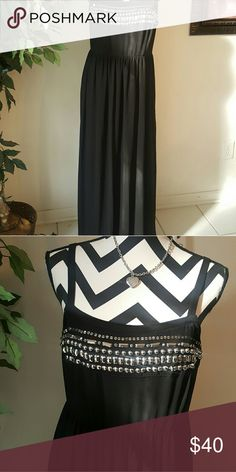 Torrid size 1 Long dress adjustable straps. Back stretches. Very comfortable and sleek looking.    Pet and smoke free home torrid Dresses