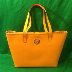 """MICHAEL KORS JET SET TRAVEL MD TOTE BAG YELLOW NWT MICHAEL KORS SAFFIANO LEATHER JET SET TRAVEL MD TOTE BAG IN VINTAGE YELLOW.                                                                                                           bonded saffiano leather; cow leather handles •dog clasp closure •interior zip pocket and 2 open pockets •polyester lining •approx. 18 x 11x 5""""; 9"""" handle drop Michael Kors Bags Totes"""