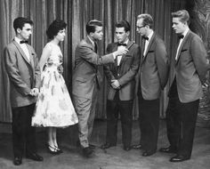 The Skyliners w/ Dick Clark (holding the microphone)