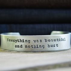 """This 1/2"""" Vonnegut quote cuff is another possible prize if you're the winner of my loop giveaway.   Look over my last few posts to see other prizes you can choose from and to enter the contest. You can win a prize from 17 possible shops!  Just be sure to follow the steps to be entered and be sure you're following all the shops in the loop!  The winner I randomly draw will choose one of the prizes offered."""
