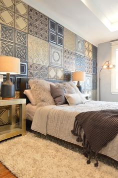 Master bedroom with an accent wall made up of ceiling tiles creating a colourful and textured accent.