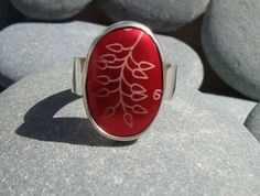 This Ring is made from silver With a striking red anodized aluminum cabochon, decorated with a leaf pattern. The ring is striking and fun. The Shank (bit that goes round the finger) is wide the Cabochon is x The ring is size R. Red Leaves, Leaf Ring, Wander, Gemstone Rings, Amp, Pattern, Silver, Jewelry, Jewlery