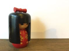 This is a beautiful handmade Japanese wooden kokeshi doll that is in wonderful condition. Her colors are vivid and bright! She doesnt mind being