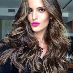 Gorgeous Izabel Goulart with pink lips and loose waves hairstyle