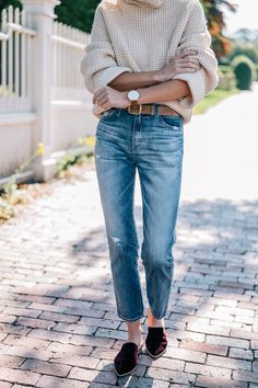 Jess Ann Kirby's fall style wearing a chunky knit turtleneck sweater, ag jeans and madewell velvet mules