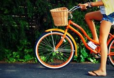 Orange bike with a basket makes me happy.