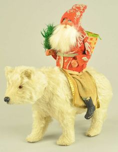 ...antique Santa on polar bear...