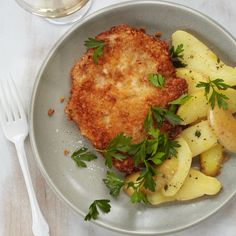 Chef Way Wolfgang Puck of Los Angeles's Spago makes his schnitzel by deep-frying cutlets of Kurobuta pork, a deeply marbled heritage meat imported fro...