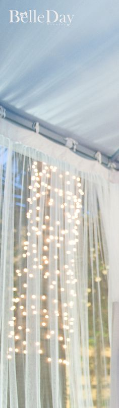 Use sheer curtains and possibly battery operated or solar strung lights for your booth! How cute