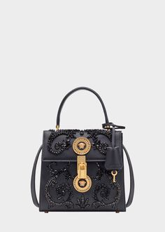 An iconic Versace bag, a timeless style crafted in exceptional quality leather. Featuring a top handle, fold over closure with round Medusa Medallion lock closure and intricate Barocco embroidery. Popular Handbags, Handbags Online, Handbags On Sale, Fall Handbags, Black Handbags, Purses And Handbags, Luxury Bags, Luxury Handbags, Versace Bag