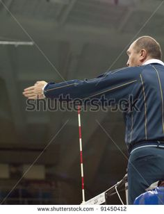 MOSCOW, RUSSIA - DECEMBER 14 : Unidentified referee in action of European League woman's volleyball team Dinamo Russia and Red Star Belgrade Serbia on December 14, 2011 in Moscow, Russia http://www.shutterstock.com/pic.mhtml?id=91450412  #net, #russia, #strike, #post, #national, #serbia, #red, #ball, #european, #serve, #reception, #star, #russian, #defense, #match, #jump, #event, #trophy, #receive, #trainer, #compete, #olympic, #team, #women, #tournament, #time, #girl, #winner, #athlete…