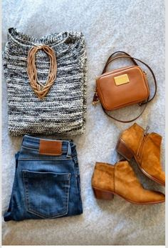 Business casual work outfit: marled black and white sweater, jeans, cognac accents and booties. I'd wear with a grey or black sweater.