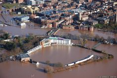 The River Severn in flood-hit Worcester earlier reached its highest level in recent years. Here you can see the stands of Worcestershire Cou...