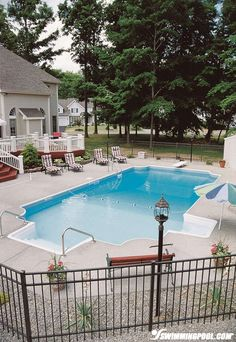 Vinyl Pool with Safety Features | Swimmingpool.com. I like the rocks etc around the pool with fencing.
