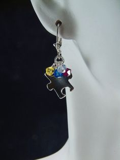 14K Gold Filled Autism Puzzle Piece Earrings Autism Awareness Support Puzzle Piece Charm Earrings. $24.00, via Etsy.