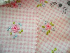sweet embroidery and cross stitch on soft pink check....I love it.