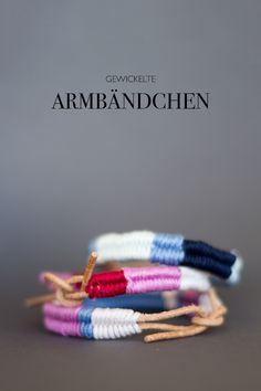 gewickelte Armbändchen, indem man Wolle oder Garn um ein Lederband wickelt…