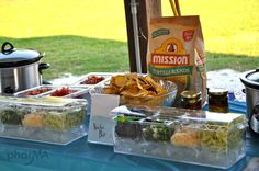 Nacho bar!  Guacamole, Sour cream, Jalapeños, beans, rice, tomatoes, unions, cilantro, chips, salsa, cheese   (Shower)