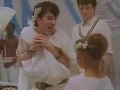Soft Cell :Tainted Love Music Video...This song is the song that best describes the 80's as Smells Like Teen Spirit best exemplifies the 90's.