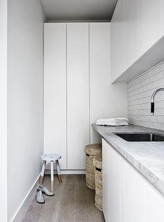 Laundry: white handleless cupboard/cabinet doors, grey marble-look stone benchtop with undermount laundry sink/basin, white handmade subway tile splash back Laundry Storage, Laundry Hamper, Laundry In Bathroom, Laundry Cupboard, Linen Cupboard, Laundry Area, Stone Benchtop, Mim Design, Small Laundry