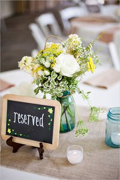 Weddings Flower Arrangements : Light and bright summery wedding. Captured By: Jen & Chris Creed .tn - Leading Flowers Magazine, Daily Beautiful flowers for all occasions Rustic Wedding Flowers, Rustic Wedding Centerpieces, Wedding Flower Arrangements, Reception Decorations, Chalkboard Wedding, Wedding Signage, Reserved Wedding Signs, Reserved Signs, Dot And Bo