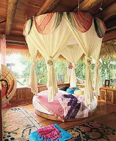 A suspended canopy and a round bed feels like a fairy tale