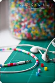 Be Different...Act Normal: Decorate Your Earbuds...adult aid required to slit beads with an exacto knife.
