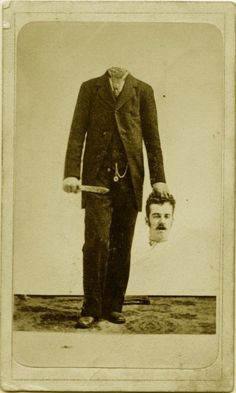 Headless Man -- you can see the stand holding his body up. A murder victim, perhaps, photographed following his death. A morbid sense of humor on someone's part.