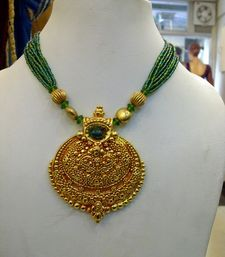 Size: Adjustable cause of Dori..Minimum size :14 inchesSpecialty : Very light Piece cause its not Embossed on metal..Embossing is very much in Detail...and is coated with Gerua Powder for South Indian Jewellery touch.