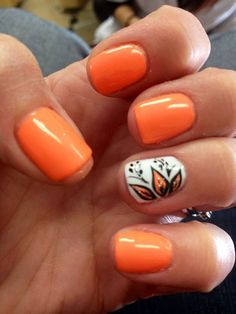 Kick off that summer vibe with this hot and bright orange nails to accompany you! Coat your nails with matte orange to resemble the intense heat of the sun. Tone it down with a white layer topped with orange and black leaves to stand out from the matte shades surrounding the ensemble.