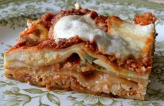 Pin It Arrabiata , meaning angry, is a classic spicy hot Roman pasta sauce, and my version here is full of fiery chili pepper flakes, scorched roasted tomatoes, and garlic.  But this particular lasagna has a kinder, gentler side to it, made with delicate fresh sheets of pasta, ricotta scooped and drained just moments before baking, milky white shards of mozzerella so fresh it's impossible to slice, and basil leaves pinched and placed as needed right from the bouquet. I made this entire dish…